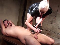 Dominant woman plays with the submissive cock in a pleasant XXX