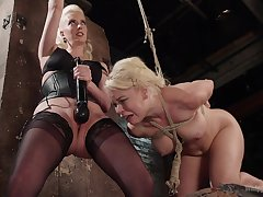 Nikki Delano moans while a mistress punishes her with toys