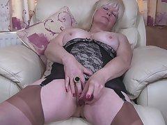 Buxom amateur mature British granny Cindy S. masturbates in pantyhose