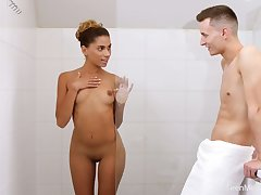Tanned GF with natural jugs Pet Nicols gives stud a blowjob in the shower