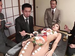 Nude Ramu Nagatsuki used as a sushi table and penetrated with a dildo