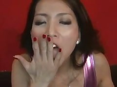 This Asian babe is a rare gem that looks great with a cum in her mouth